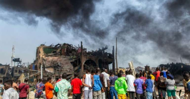 The blast destroyed buildings, lorries and cars.  By Benson IBEABUCHI (AFP/File)