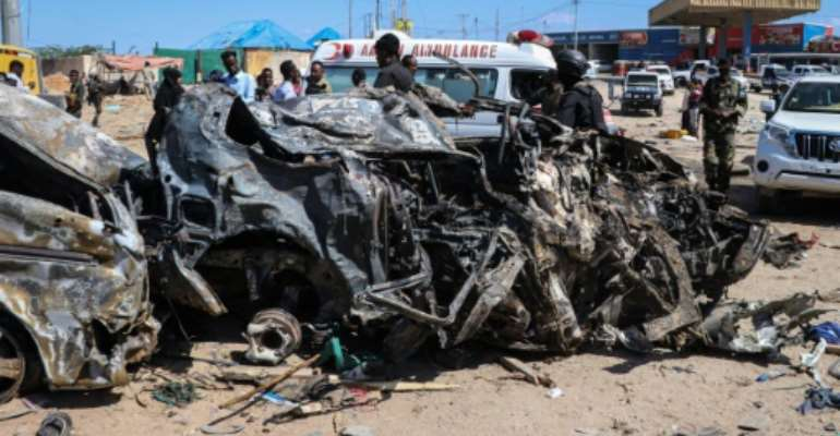 The blast left the wreckage of surrounding vehicles at the busy checkpoint and crossroads.  By Abdirazak Hussein FARAH (AFP)