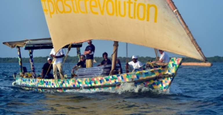 The boat is covered in a brightly-coloured patchwork of 30,000 flip-flops, which like the rest of the raw material was collected from Kenyan beaches and towns.  By ANDREW KASUKU (AFP)