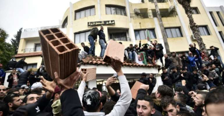 The brick has become the symbol of the anti-vote campaign in Algeria's Kabylie heartland of the Berber community.  By RYAD KRAMDI (AFP)