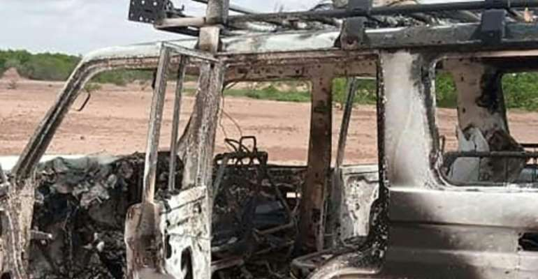 The burnt-out vehicle of eight people, including six French citizens, that was attacked by unidentified gunmen in southwest Niger.  By  (AFP)