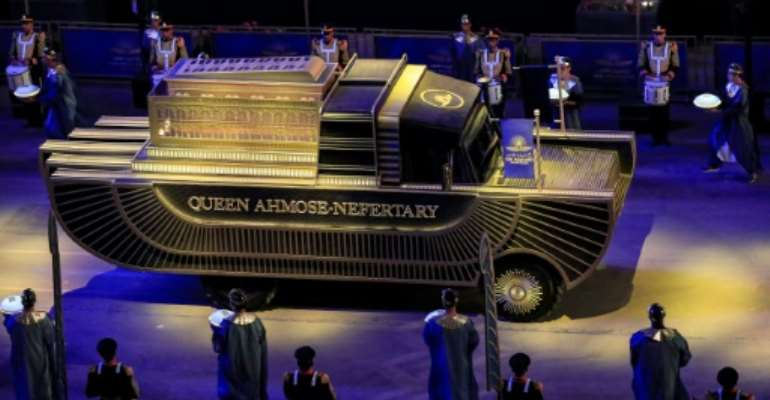 The carriage carrying the remains of Queen Ahmose-Nefertari, daughter of Pharaoh Seqenenre Tao II, advances as part of the parade of 22 ancient Egyptian royal mummies in Cairo Saturday.  By Khaled DESOUKI (AFP)