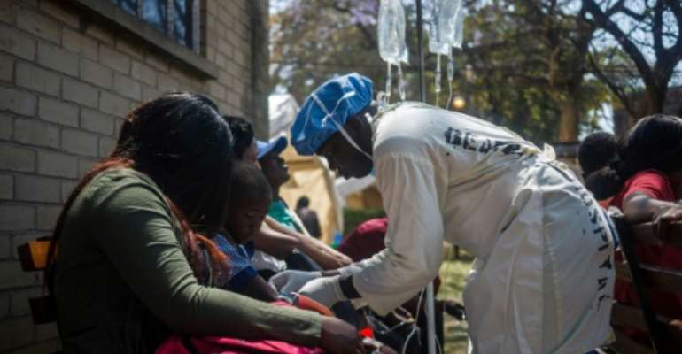 The cholera outbreak, first detected in a township outside Harare, has spread to other towns as well as rural areas across the country.  By Jekesai NJIKIZANA (AFP)