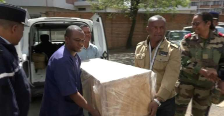The coffin containing the remains of British Cambridge University student Alana Cutland was carried out from the morgue.  By Volana RAZAFIMANANTSOA (AFP)