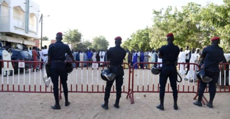 The court case in the northern Senegal was held amid tension as police blocked roads and supporters of the teacher, Cheikhouna Gueye, gathered behind barriers.  By SEYLLOU (AFP)