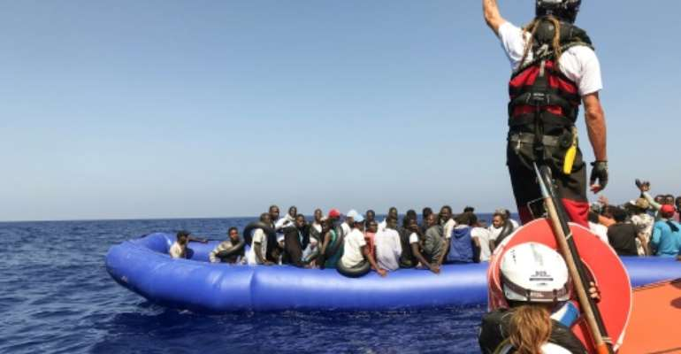 The crew of the  rescue ship 'Ocean Viking' regularly go to the aid of the makeshift vessels attempting the dangerous Mediterranean crossing to Europe.  By Anne CHAON (AFP/File)