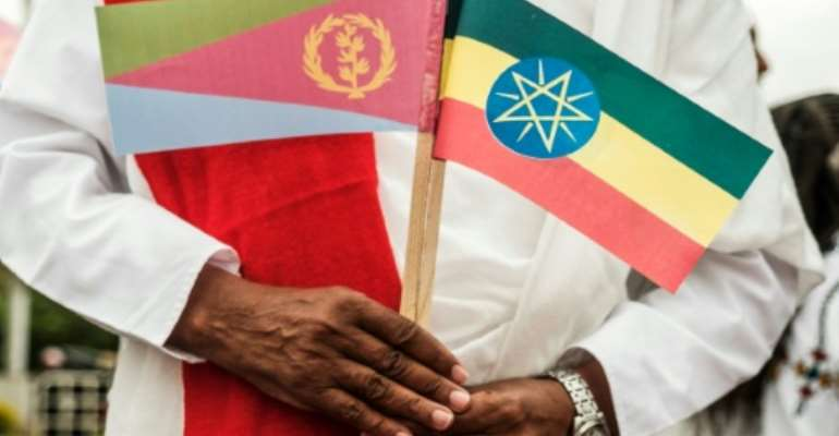 The detente between Eritrea (flag on the left) and Ethiopia lifted a long and damaging cold war between the neighbours.  By EDUARDO SOTERAS (AFP/File)