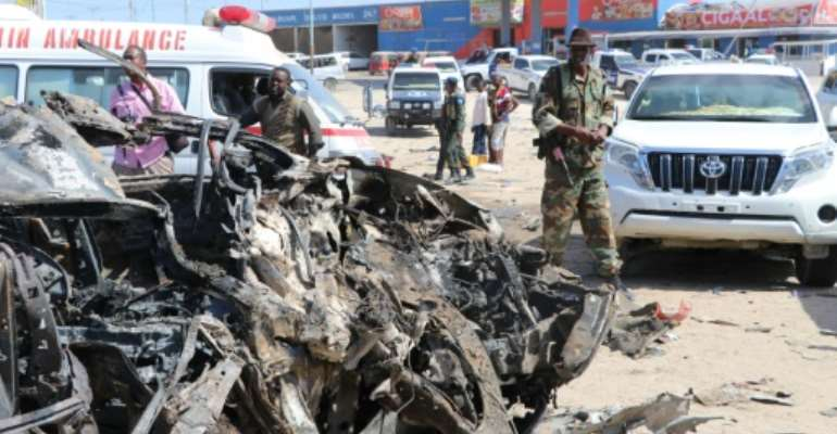 The devastating car bomb blast ripped through a busy area of the Somali capital.  By Abdirazak Hussein FARAH (AFP)