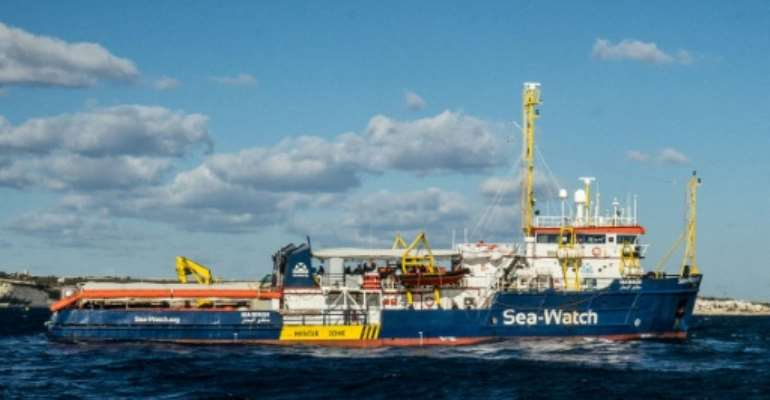 The Dutch-flagged rescue vessel Sea Watch 3 docked despite the best efforts of a coastguard boat to prevent her from doing so.  By FEDERICO SCOPPA (AFP/File)
