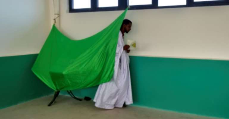 The election is the first in Mauritania's coup-strewn history that looks set to see an elected president transfer power to an elected successor.  By SIA KAMBOU (AFP)