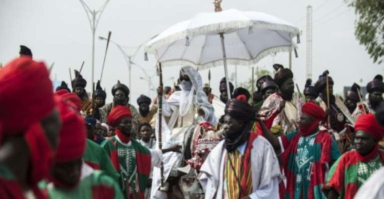 The Emir of Kano (C), Muhammadu Sanusi II is at the centre of tensions between new and old styles of governance.  By STEFAN HEUNIS (AFP)