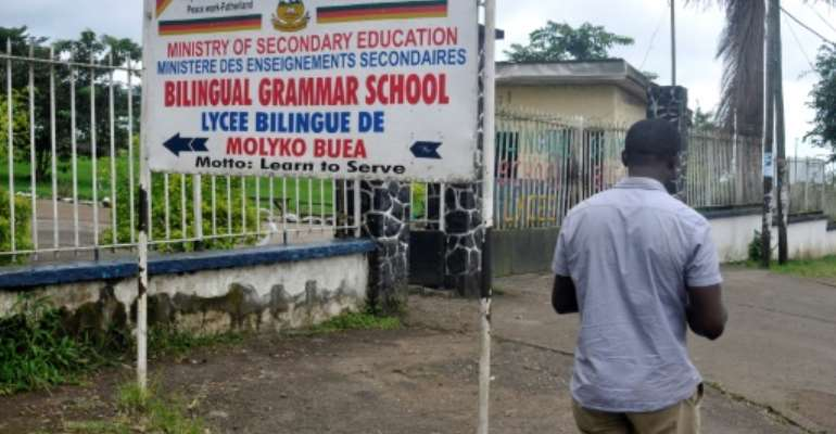 The entrance to the bilingual high school in Buea, capital of the Southwest region of Cmaeroon. Schools are high stakes in the separatist crisis wracking the two largely English-speaking regions of a mostly francophone country.  By Rennier KAZE (AFP/File)
