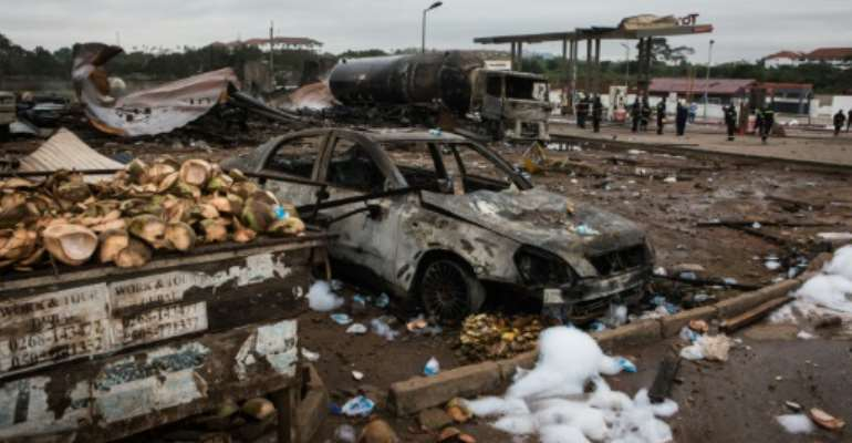 The fire and blasts gutted a liquefied gas filling station and a nearby petrol station in a suburb of Accra..  By Ruth McDowall (AFP)