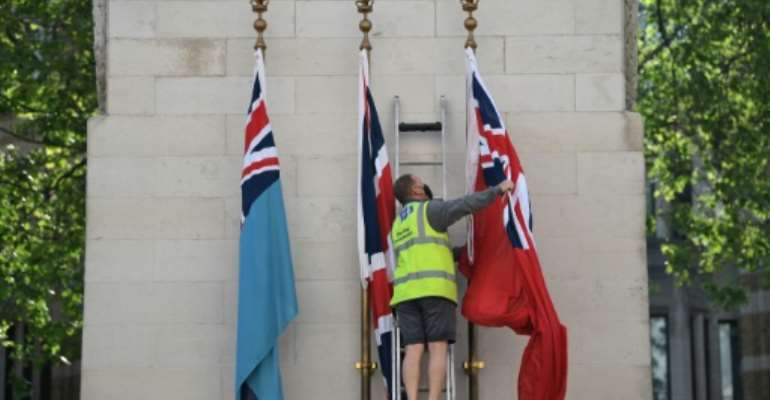 The flag of the Royal Air Force, Union Flag and the flag of Merchant Navy are raised on the Cenotaph war memorial in Whitehall, London.  By DANIEL LEAL-OLIVAS (AFP)