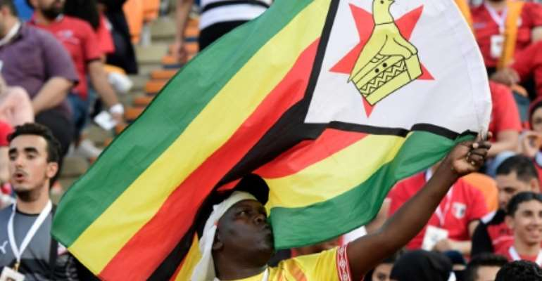 The flag of Zimbabwe, which became independent on April 18, 1980.  By JAVIER SORIANO (AFP/File)