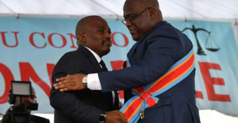 The formation of the new government by Felix Tshisekedi is being closely watched for signs that his predecessor Kabila will continue to hold sway in the nation's politics. Kabila, left, is shown here handing over power to Tshisekedi in January.  By TONY KARUMBA (AFP/File)