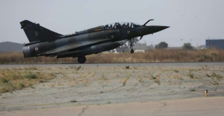 The French military has said Mirage 2000 jets, seen here, struck an armed convoy on three days this week, destroying about 20 of roughly 50 pickup trucks.  By Ludovic MARIN (AFP/File)