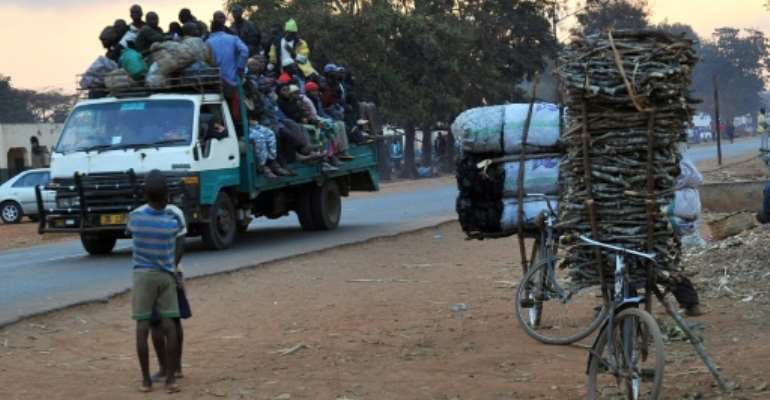 The fuel shortage has forced many Malawians to cycle.  By ALEXANDER JOE (AFP/File)