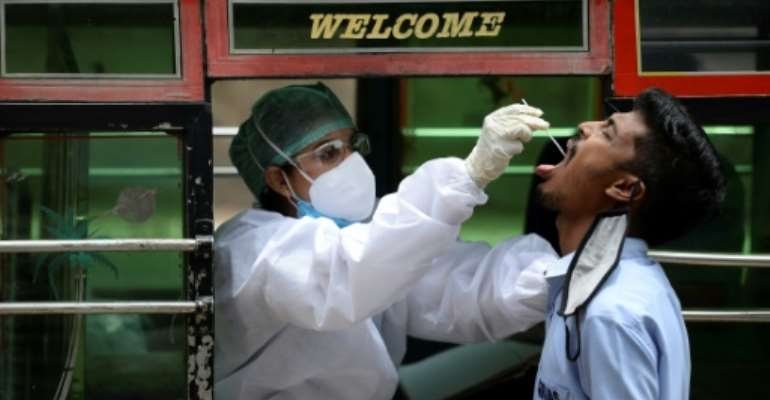 The global death toll from the coronavirus has risen to 916,000 with 28.5 million infections.  By Arun SANKAR (AFP)