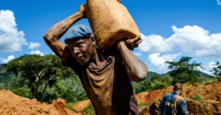 The gold sector provides jobs to nearly 10 percent of the country's population, according to the report by the International Crisis Group..  By Jekesai NJIKIZANA (AFP)