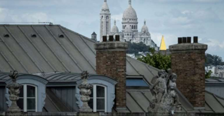 The Goutte d'Or is a stone's throw from the emblematic artists' quarter of Montmartre and its famous Sacre Coeur basilica in Paris's touristy 18th arrondissement, but a world apart.  By JOEL SAGET (AFP/File)