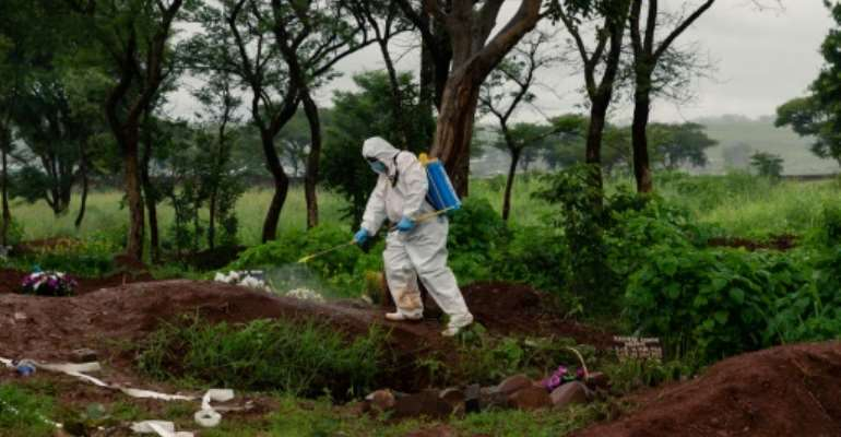 The government has defended its decision to limit funeral rites, pointing to the worsening coronavirus outbreak.  By Jekesai NJIKIZANA (AFP)
