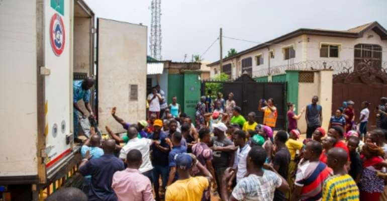 The government has promised to distribute food to the poor in Lagos to see them through the lockdown, but the challenge is huge.  By Benson IBEABUCHI (AFP)