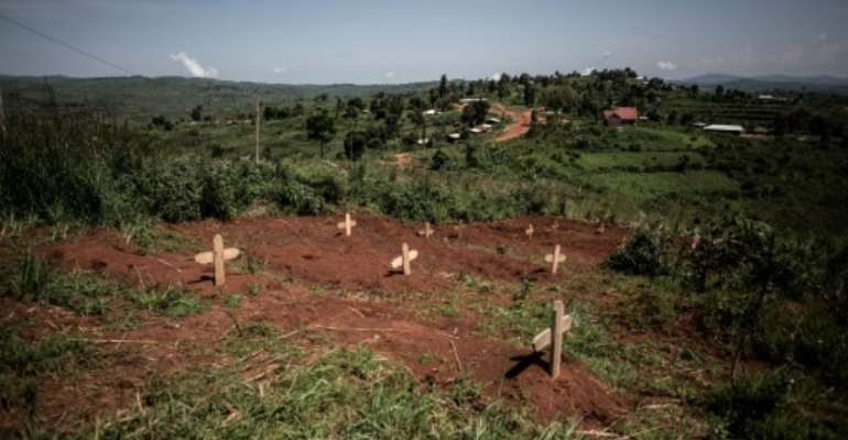 The graves of DR Congo soldiers are pictured outside a base in Djugu, DR Congo in July 2019.  By John WESSELS (AFP/File)