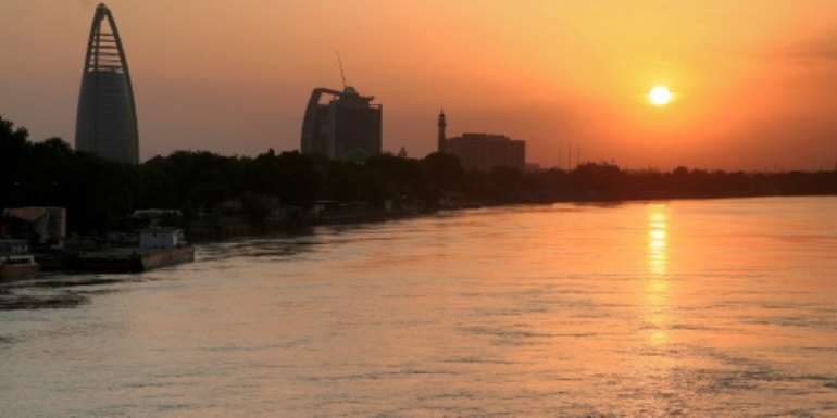 The Greater Nile Petroleum Oil Company (GNPOC) Tower and PetroDar Operating Company (PDOC) Tower (left to right) near the Blue Nile riverfront in Sudan's capital Khartoum at sunset.  By Ebrahim HAMID (AFP/File)