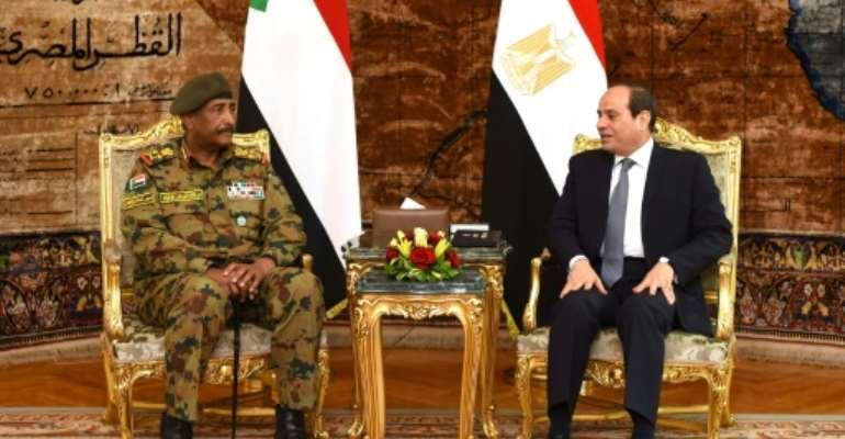 The head of Sudan's military council, General Abdel Fattah al-Burhan (L),  met last week with Egyptian President Abdel Fattah al-Sisi ahead of a visit to Saudi Arabia this week.  By STRINGER (EGYPTIAN PRESIDENCY/AFP/File)