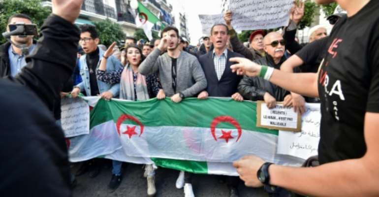 The Hirak movement has staged anti-government rallies in Algiers and other cities every week since February.  By RYAD KRAMDI (AFP)