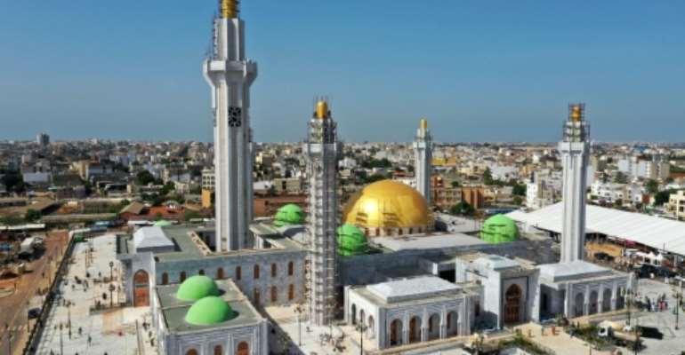 The huge Massalikul Mosque has risen from swampy land in the rundown district of Bopp.  By Adrien BARBIER (AFP)