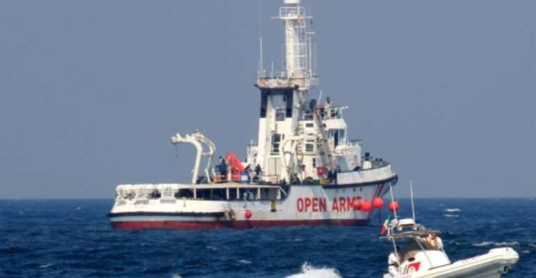 The humanitarian vessel run by Spanish NGO Open Arms is the only one operating in the Mediterranean right now, with others run by non-governmental groups held for various reasons in Italian ports.  By Alessandro FUCARINI (AFP/File)