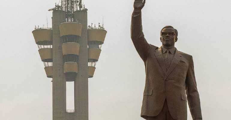 The imposing statue of first prime minister after independence Patrice Lumumba dominates the traffic in Kinshasa.  By Arsene MPIANA (AFP)
