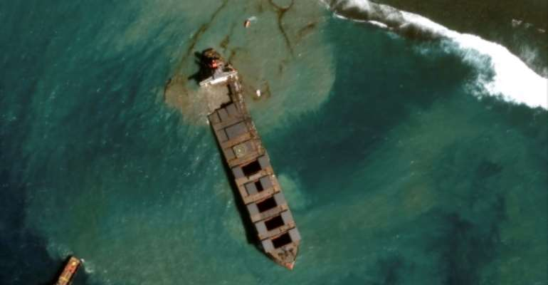 The Japanese operator of a boat that spilled oil off the coast of Mauritius has pledged $9.4 million in funds to help clean-up and recovery efforts.  By Handout (Satellite image ©2020 Maxar Technologies/AFP/File)