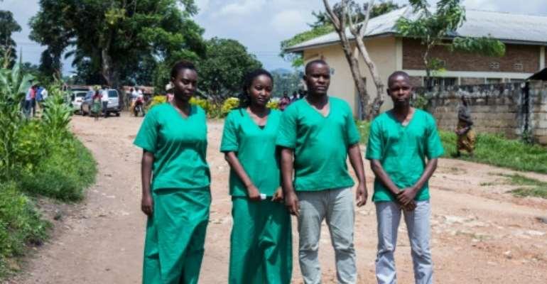 The journalists of the Burundi's independent media Iwacu Press Group,(L to R) Christine Kamikazi, Agnes Ndirubusa, Terence Mpozenzi and Egide Harerimana were handed jail terms.  By Tchandrou Nitanga (AFP)