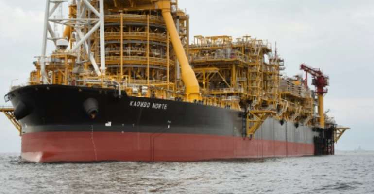 The Kaombo Norte, an oil tanker converted into a FPSO vessel (Floating Production Storage and Offloading), in November 2018. Its sister ship, the Kaombo Sul, has begun operating off the coast of Angola, French oil company Total said Tuesday.  By Rodger BOSCH (AFP/File)