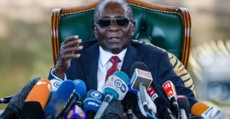 The location of Mugabe's burial was unclear, with his family and President Emmerson Mnangagwa's government apparently at odds over whether it would be at his homestead or at a shrine for liberation heroes in the capital Harare.  By Jekesai NJIKIZANA (AFP)