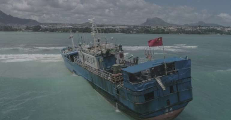 The Lurong Yuan Yu ran aground on a reef on the northwest of Mauritius.  By - (L'Express Maurice/AFP)