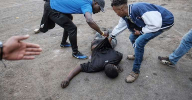 The man was fatally shot in the stomach during protests over alleged election fraud.  By MARCO LONGARI (AFP)