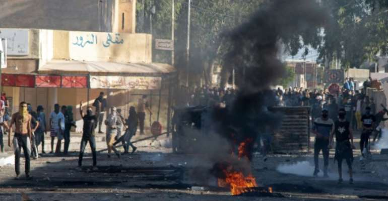 The man's death sparked protests, with angry residents throwing rocks at security forces who responded with tear gas.  By MOHAMED ZARROUKI (AFP)