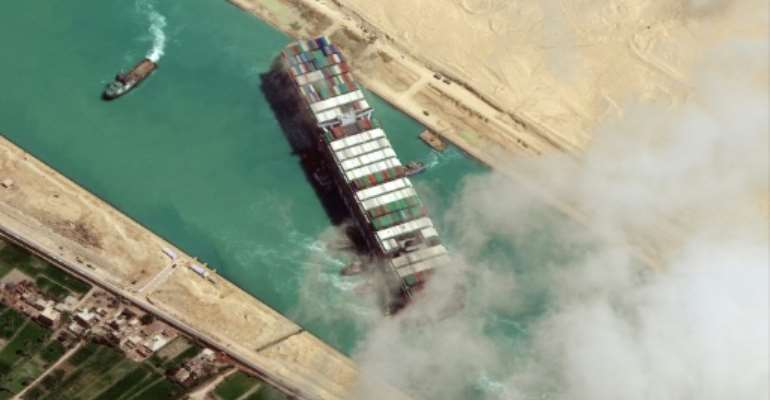 The MV Ever Given container ship blocked the Suez Canal for six days in March, crippling global supply lines and costing billions.  By - (Satellite image ©2021 Maxar Technologies/AFP/File)