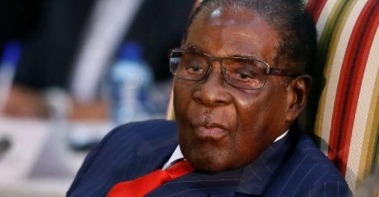 The naming of Zimbabwean President Robert Mugabe as a goodwill ambassador for the World Health Organization has triggered widespread outrage.  By Phill Magakoe (AFP/File)