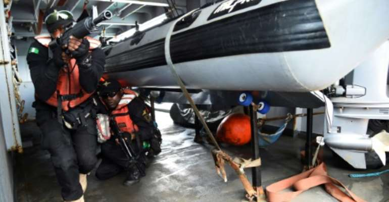 The Nigerian Navy Special forces have trained to tackle piracy.  By PIUS UTOMI EKPEI (AFP)
