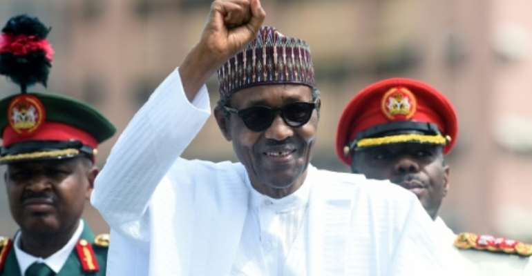 The Nigerian president should sign up to the AfCTA, a report recommends.  By PIUS UTOMI EKPEI (AFP)