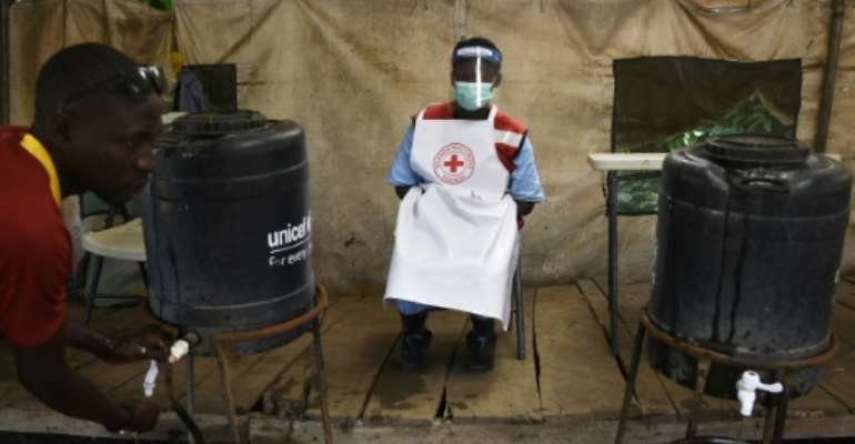 The outbreak is being fought with time-honoured techniques of tracing and isolating people who have been in contact with Ebola patients, and urging the public to wash their hands.  By ISAAC KASAMANI (AFP)