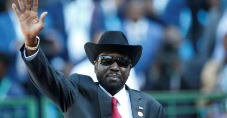 The peace deal calls for a unity government between South Sudan President Salva Kiir (C) and rival Riek Machar.  By SIPHIWE SIBEKO (POOL/AFP)