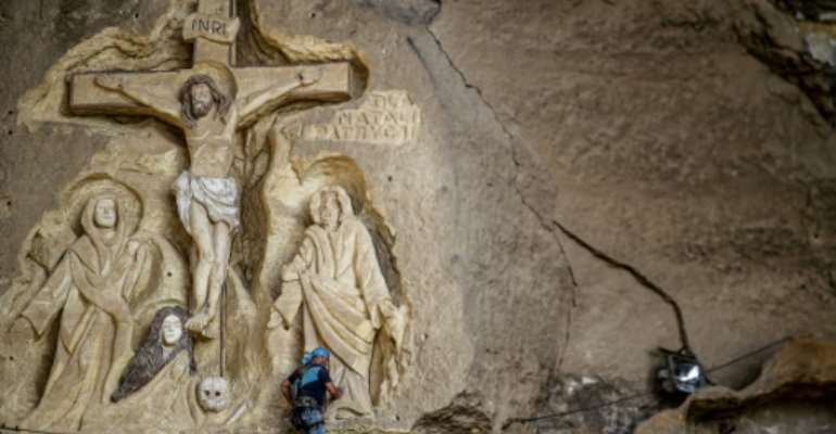 The Polish artist has spent more than two decades carving the rugged insides of the seven cave churches and chapels of the monastery with designs inspired by biblical stories.  By Mohamed el-Shahed (AFP)