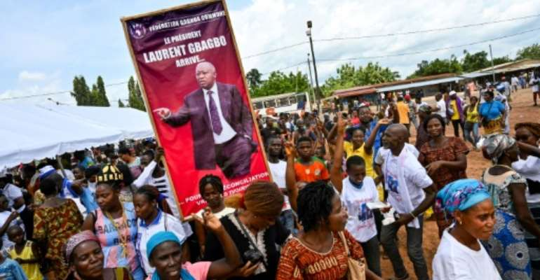 The poster reads 'President Laurent Gbagbo arrives for a true reconciliation of Ivorians', but critics are wary.  By SIA KAMBOU (AFP)