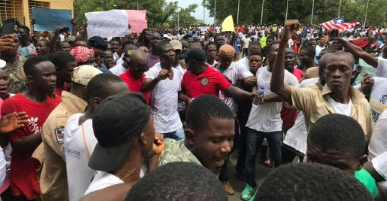 The protest was led by lawmaker Yeke Korlubah (centre, in white shirt), one of Weah's most vociferous critics.  By CARIELLE DOE (AFP)